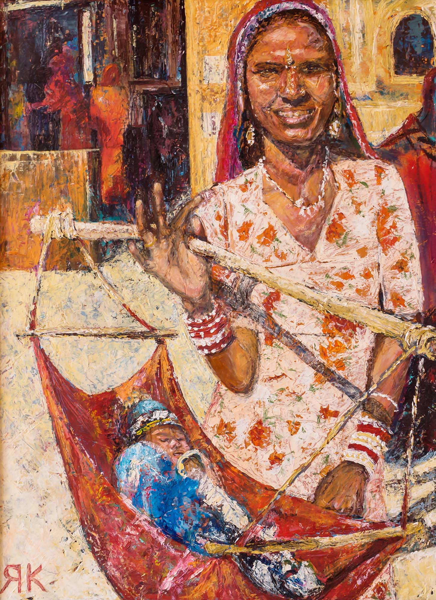 Indian woman holding a baby by Ria Kieboom