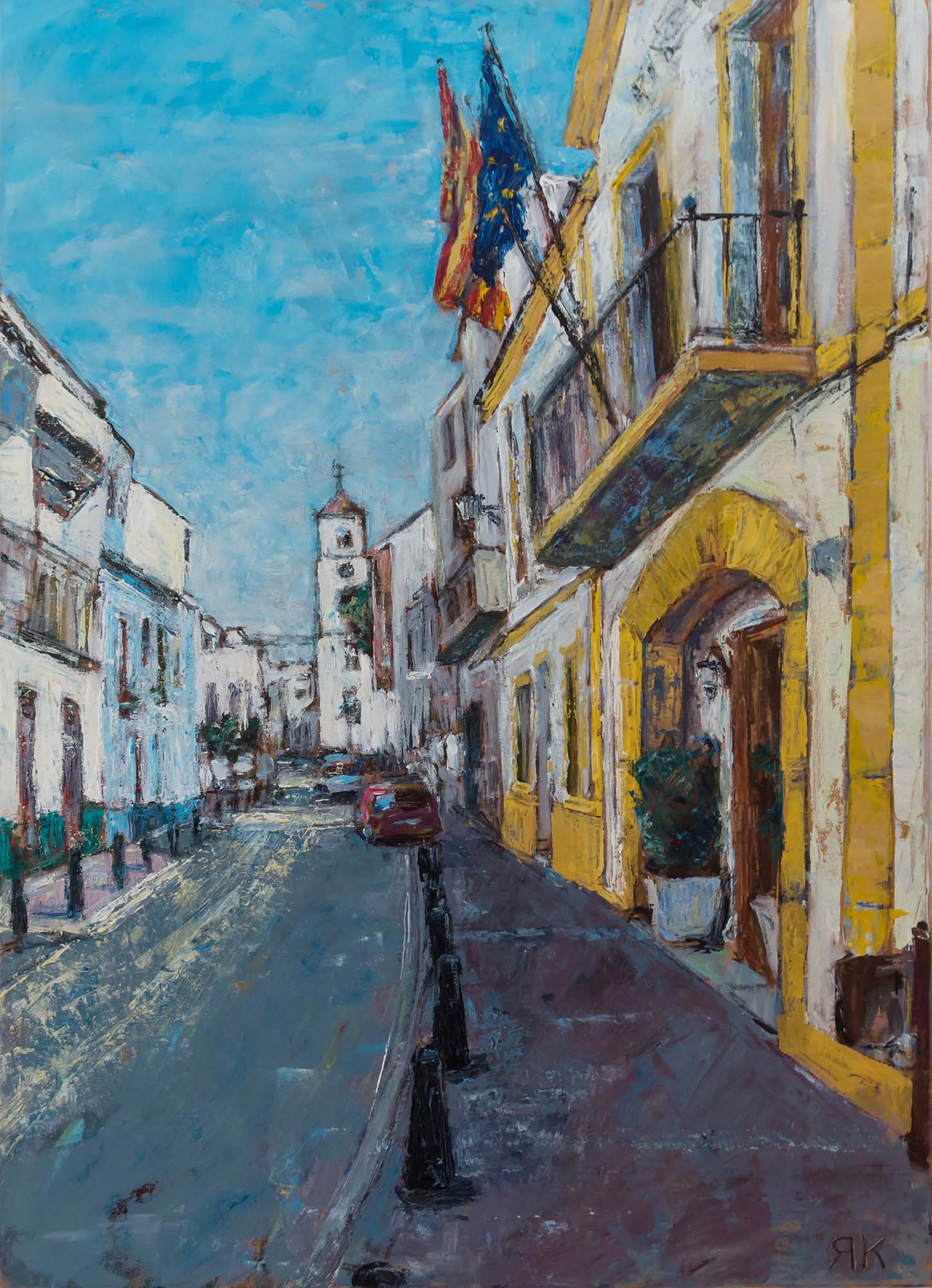 Spanish street with flags and church tower by Ria Kieboom