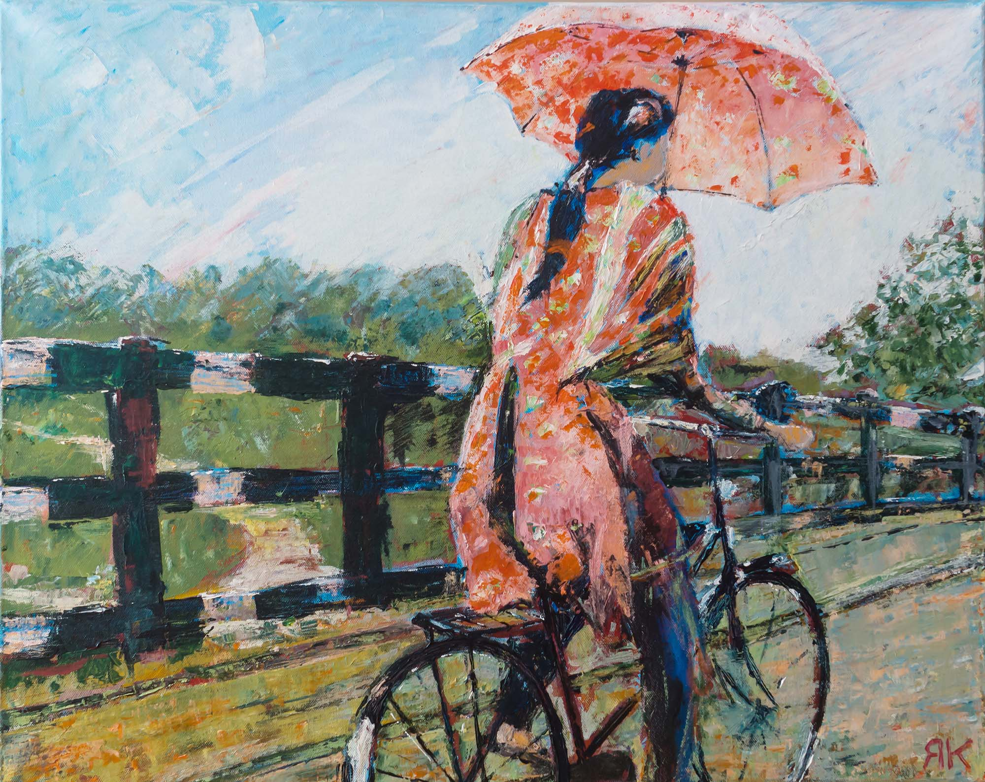 Vietnamese woman with umbrella on bicycle by Ria Kieboom
